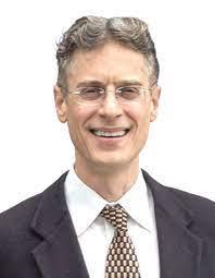 Portrait of a man wearing suit, tie, glasses